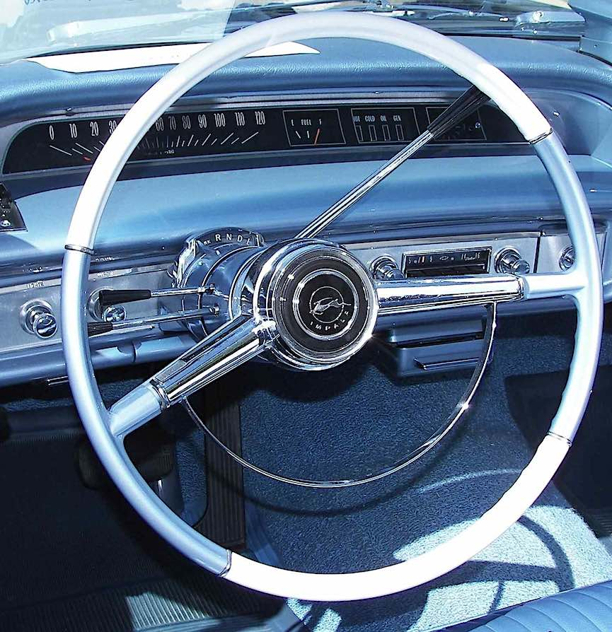 a blue 1964 Impala dashboard with a convertible rooftop