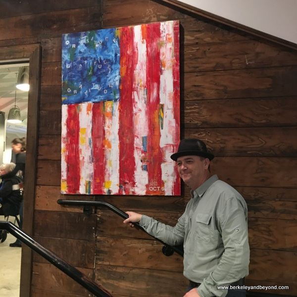 owner Andrew Pryfogle with flag painting at Tips Roadside in Kenwood, California