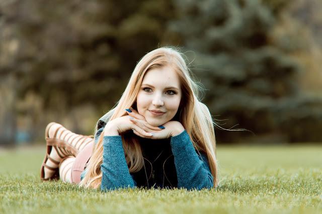 a girl poses for senior portraits in Boulder Colorado