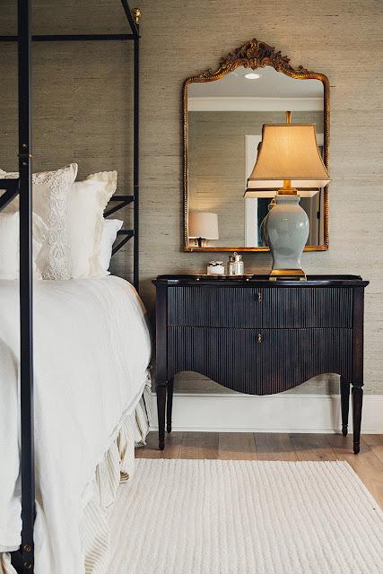 mirror bedrooms and black nightstand
