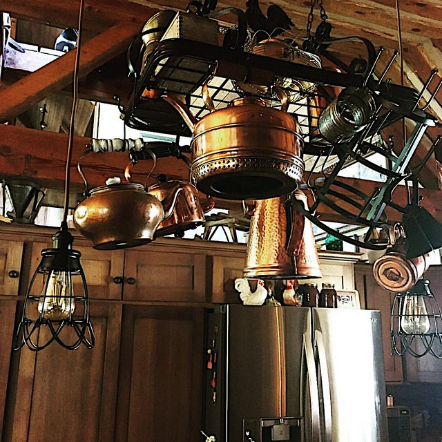 Old World style post and beam cabin kitchen, copper
