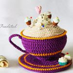 http://www.ravelry.com/patterns/library/violet-cup-pincushion
