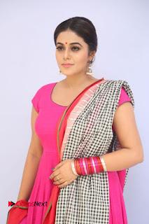 Actress Poorna Pictures in Red Salwar Kameez at Jayammu Nischayammu Raa Teaser Launch 0004