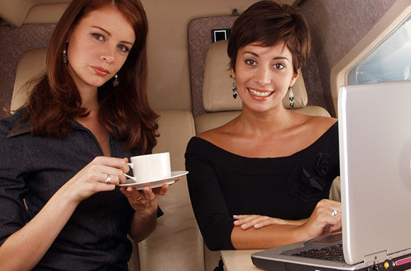 woman-drinking-coffee-on-plane