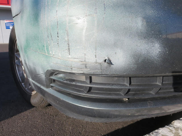 Scam repair--damage remains & overspray on trim--prior to real repairs at Almost Everything Auto Body