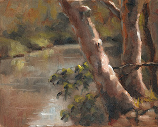 Oil painting of eucalypt trunks beside a river.