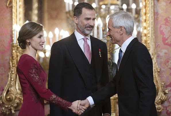 Queen Letizia attends the annual Foreign Ambassadors reception at the Royal Palace. Queen Letizia wore Felipe Varela Long sleeve dress in red diamond earrings