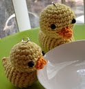 http://www.ravelry.com/patterns/library/crochet-duckie-duckie-charm-doll-toy