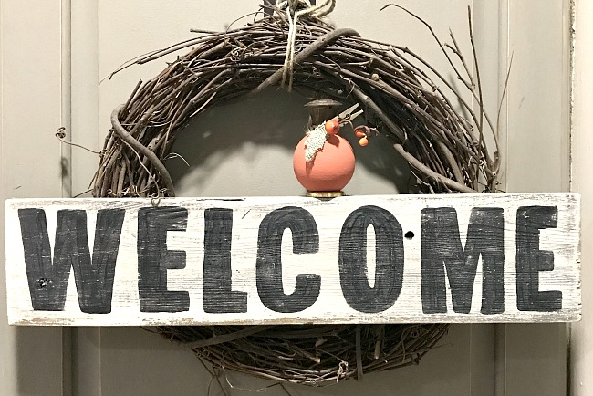 mini diy pumpkin on welcome sign