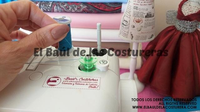 devanado o enrollado de hilo en la bobina de la máquina de coser
