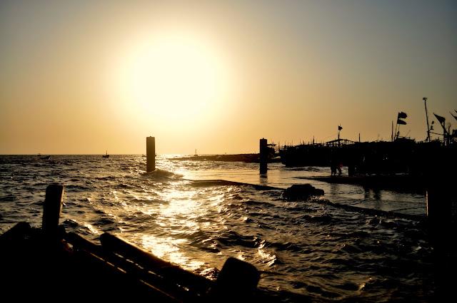 Daman sea Gujarat Travel Tourism Guide boats sunset golden light