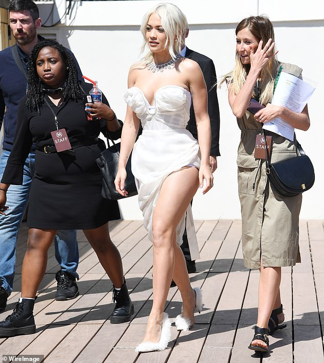 Rita Ora shows off incredible figure in a jaw-dropping white dress