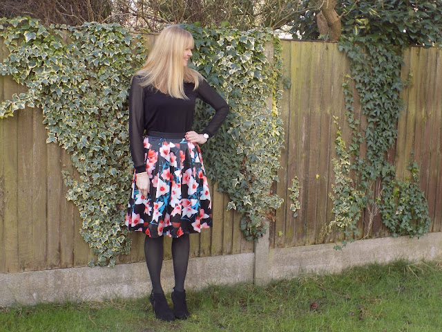 Floral skirt with black opaque tights and black ankle boots