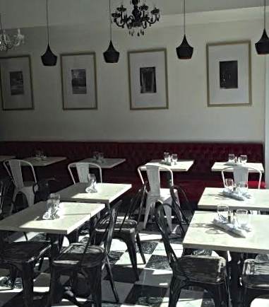 a bespoke tip came in that cafe dandy on adam clayton powell by west 115th street has now opened black white and red appears to be the decor motif of this