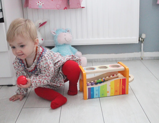 traditional wooden baby toy a colourful music box with wooden balls and xylophone