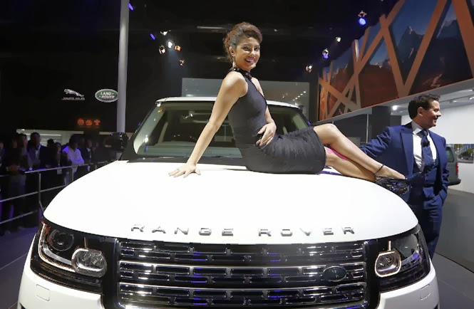 Bollywood actress Priyanka Chopra poses with Jaguar Land Rover's Range Rover LWB during its launch at the Auto Expo in Greater Noida. (Reuters Photo)
