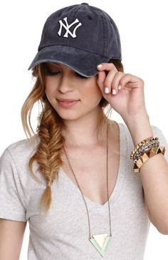 Girl on White Background with braid wearing a baseball hat