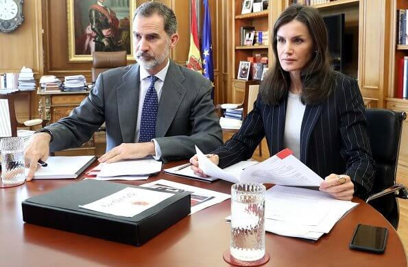 CARITAS Spain, which is the Catholic Church's organization in Spain. Queen Letizia wore Hugo Boss crew-neck sweater