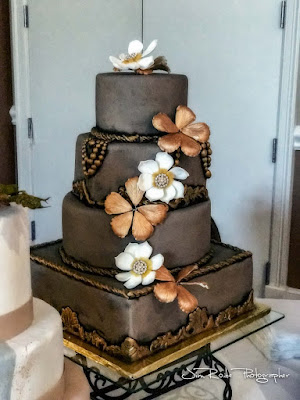 brown wedding cake with sugared flowers