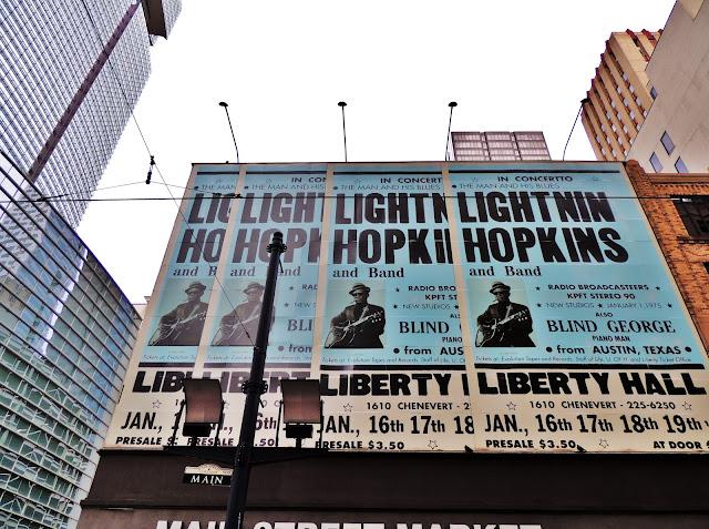 Lightnin Hopkins posters adorning facade on Main Street, Houston Texas