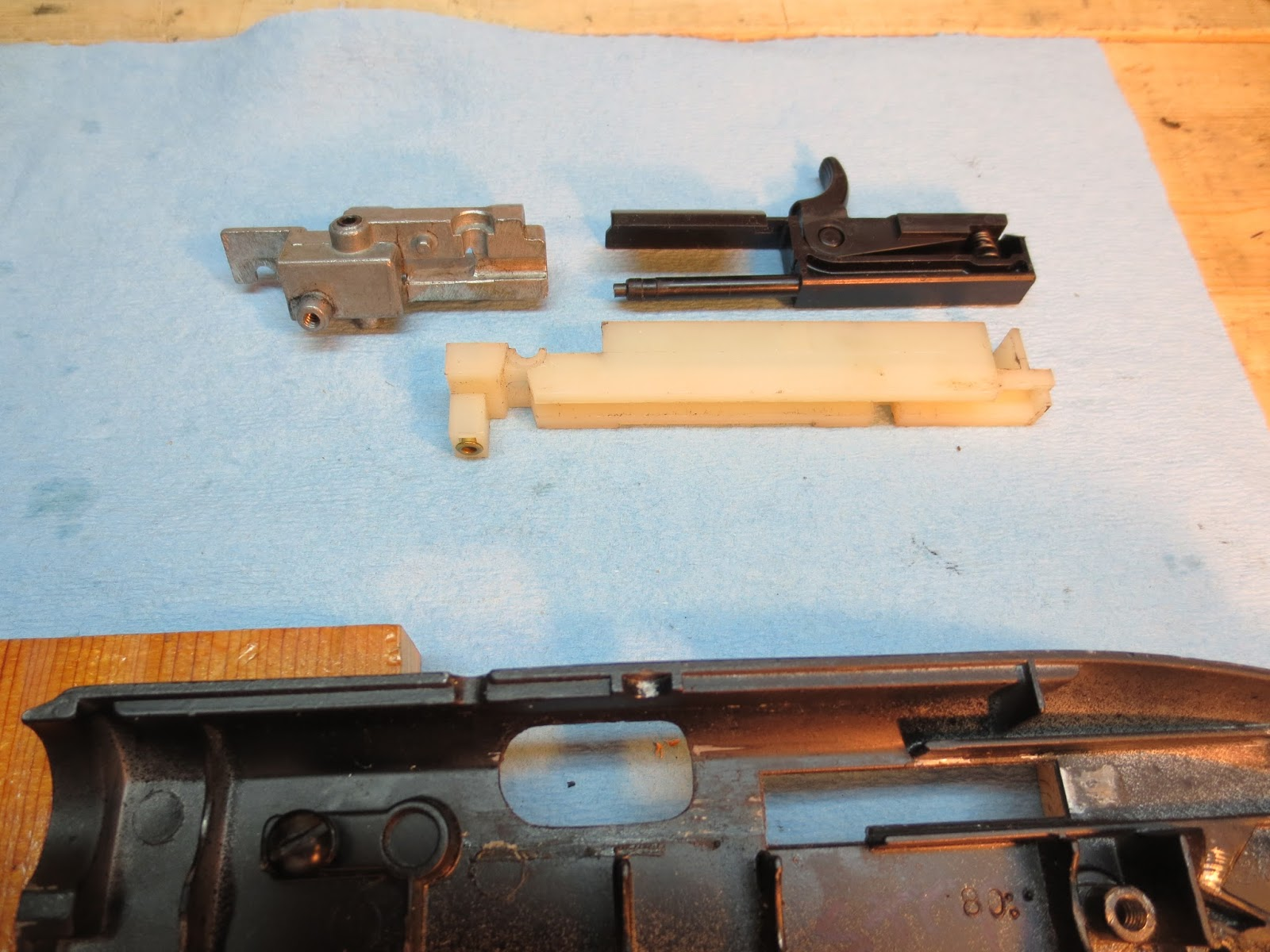 small resolution of the parts assembled and installed in the receiver half one of the few differences from the 2100 is the screw that holds the breech in place