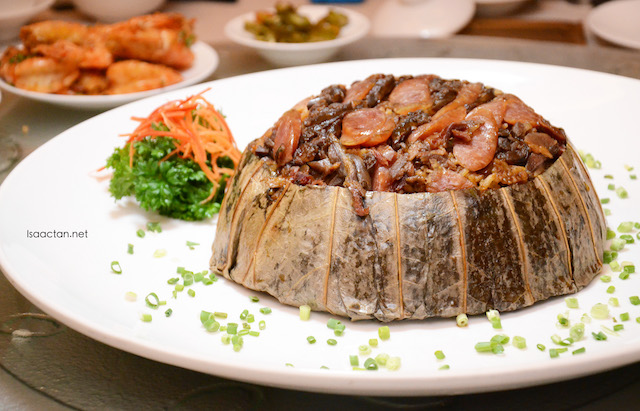 Steamed Rice with Preserved Assorted Meat, Yam and Chicken Sausages wrapped in Lotus Leaves