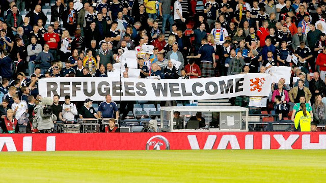 Refugees Welcome banner at soccer match