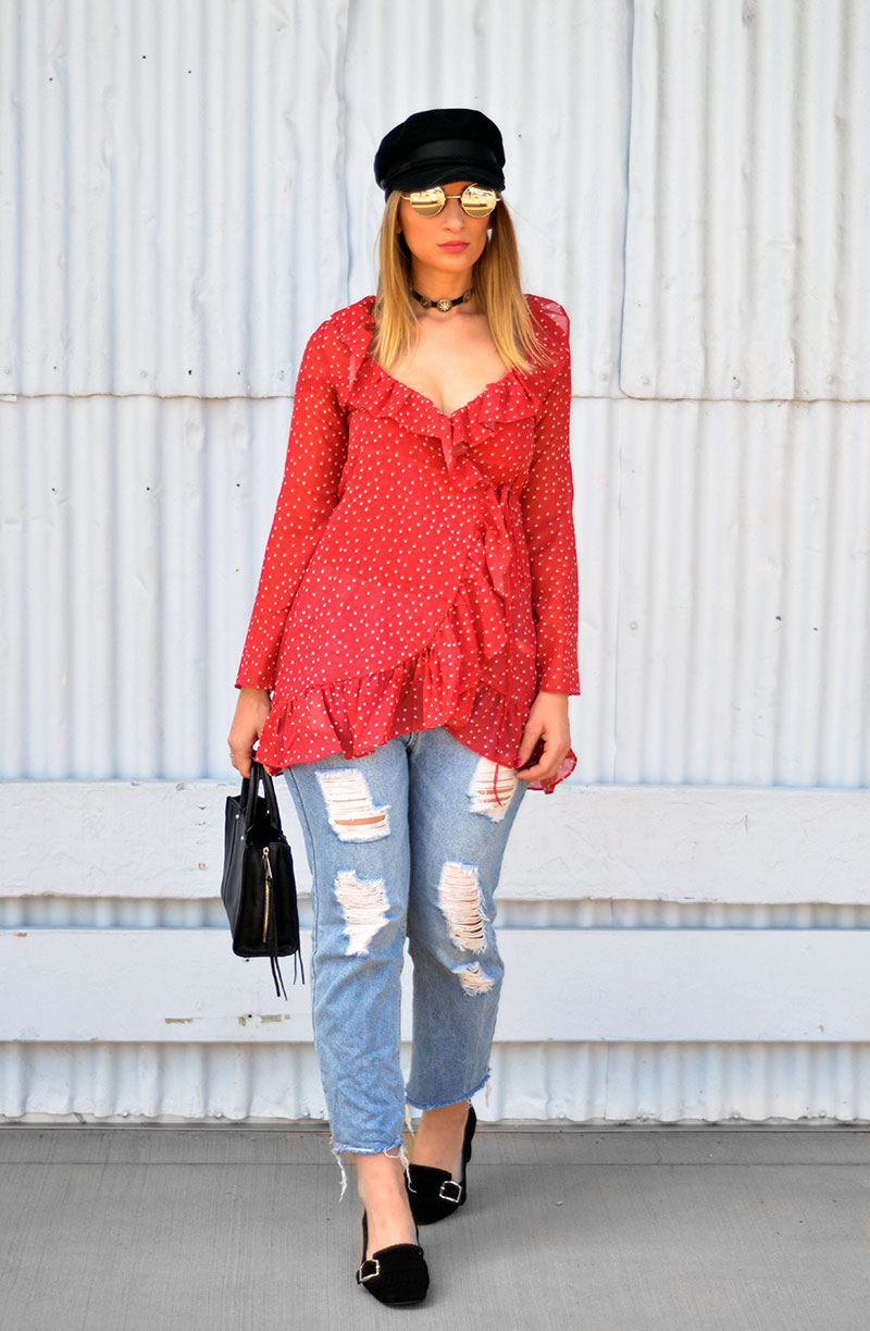 styling the wrap blouse trend red star print wrap top baker boy hat and distressed jeans