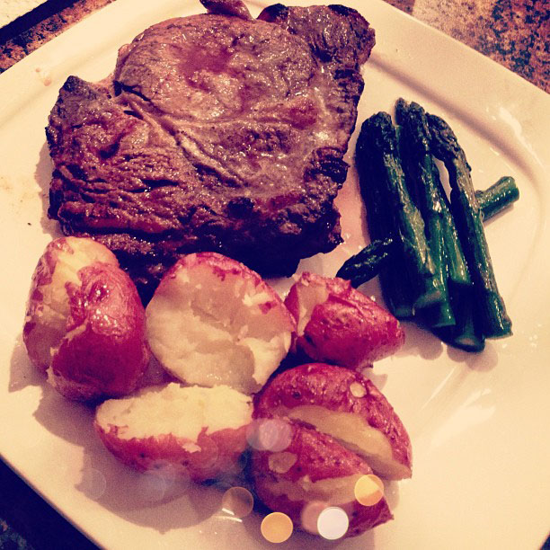 steak dinner, pink potatoes, asparagus