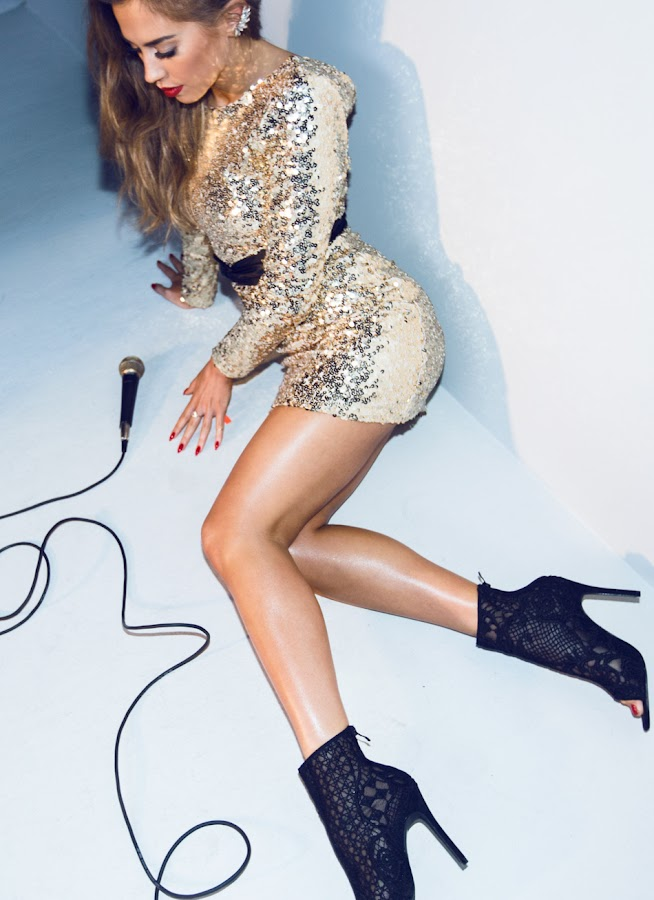 Kenza Zouiten in a sequin mini dress
