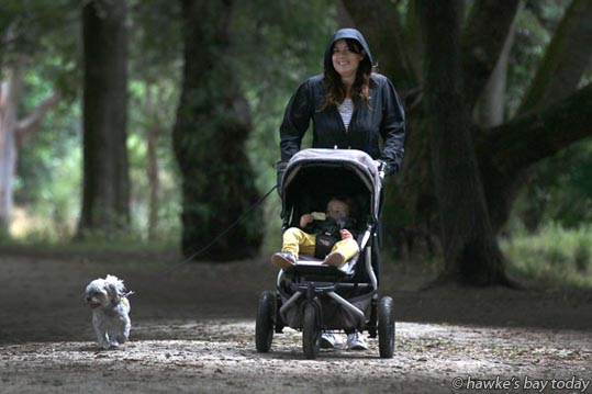 Melissa Bell, Hastings, walking with her dog at Pakowhai Country Park, Hastings, in light showers, cool weather. photograph