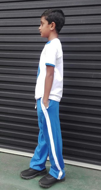 Boy in blue jogger pants