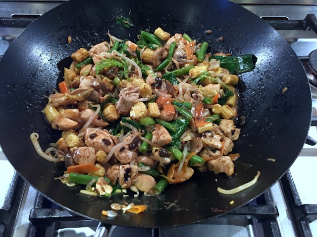 black bean sauce added to stir fry vegetables and chicken