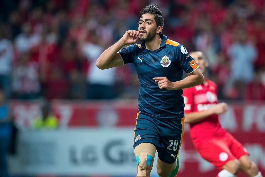Rodolfo Pizarro festejando su gol ante Diablos.