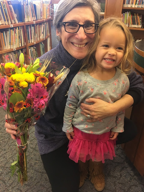 Handing out flowers at the library