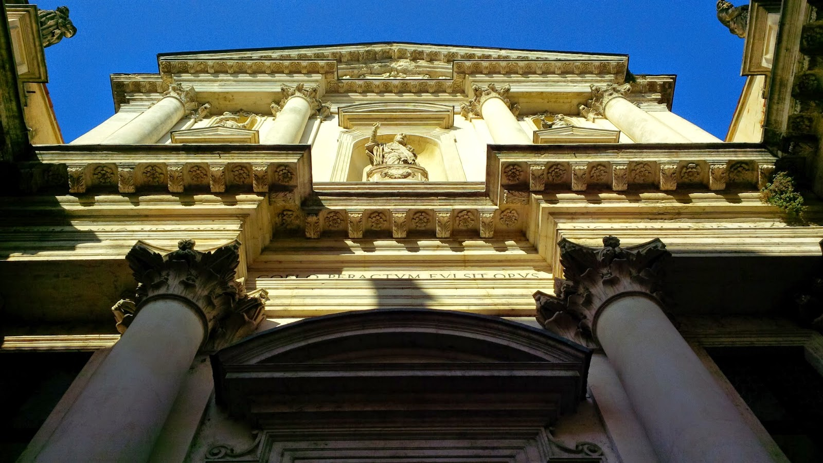 The sun lights up the facade of a church in Vicenza