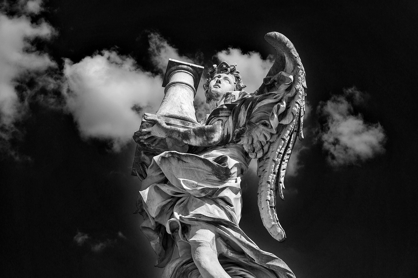 Angel with the Column by Antonio Raggi on Ponte Sant'Angelo in Rome, Italy