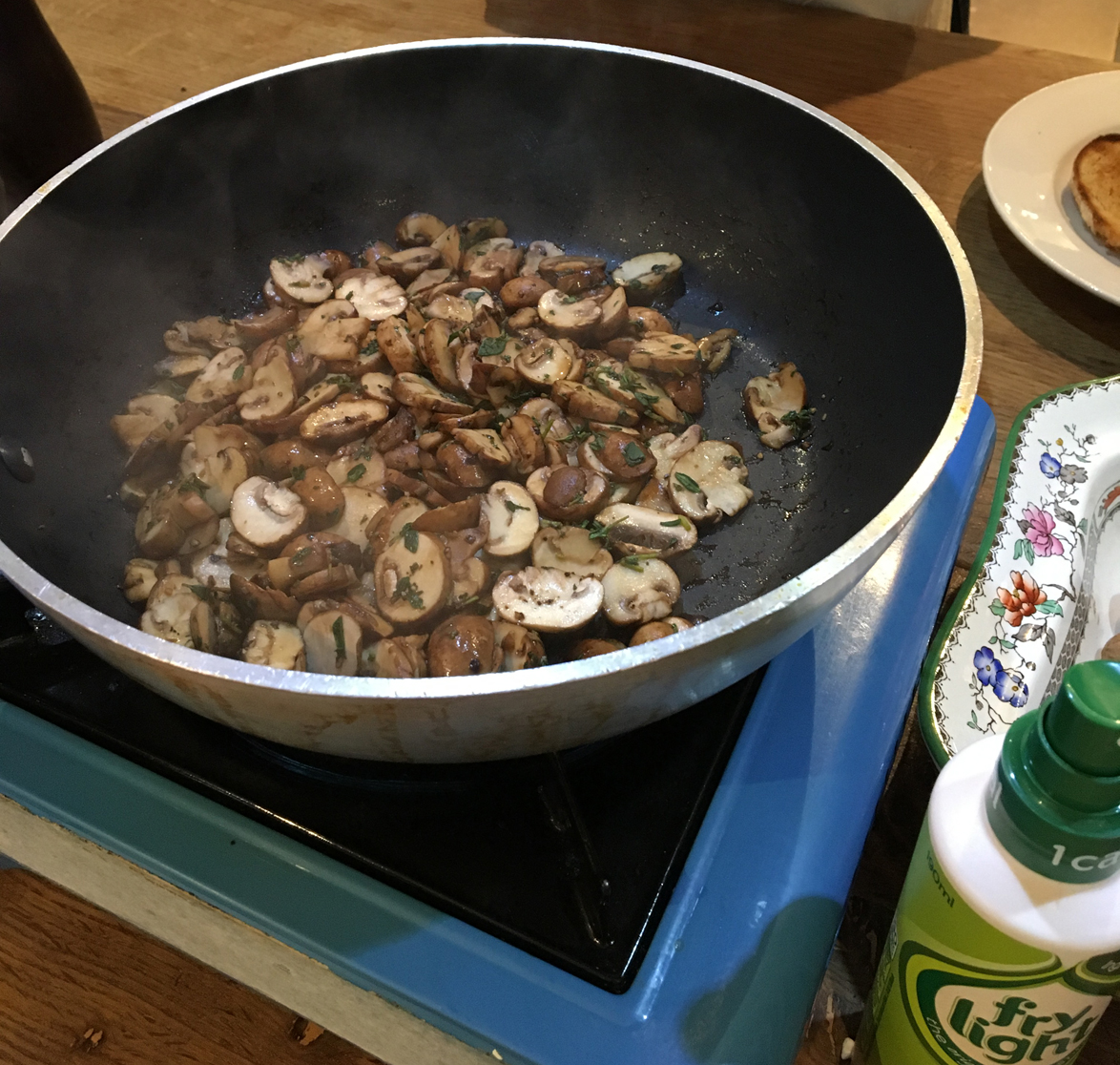 Mushrooms cooking in a pan