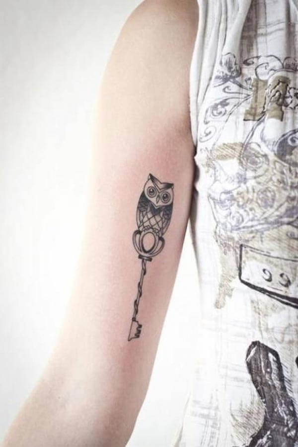 owl arm women tattoo