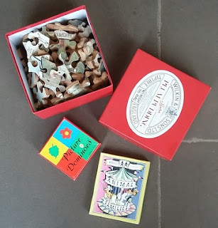 Picture of retro toys including a wooden jigsaw, card games and wooden blocks when we went round to play at the grandparents
