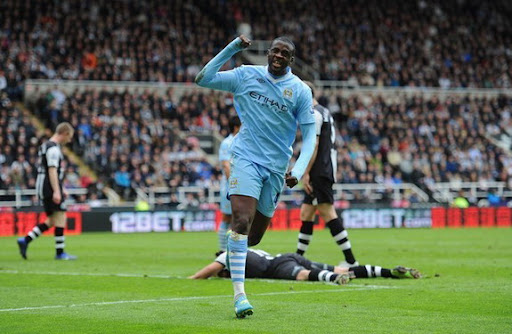 Manchester City midfielder Yaya Touré celebrates after scoring his second goal against Newcastle