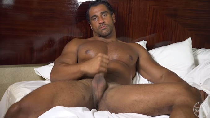 Muscley hot gay hunk sits on cock