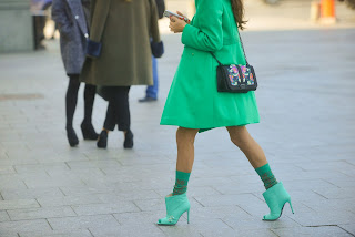 woman in green dress with ankle boots