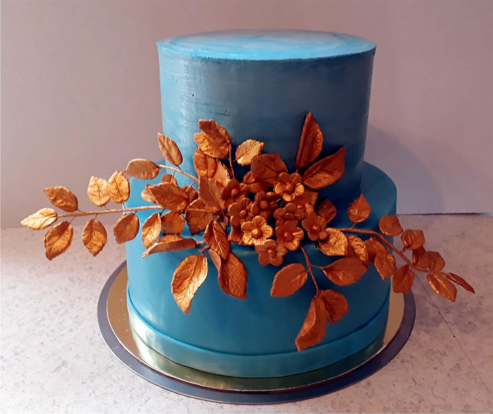 Hochzeitstorte In Blau Gold