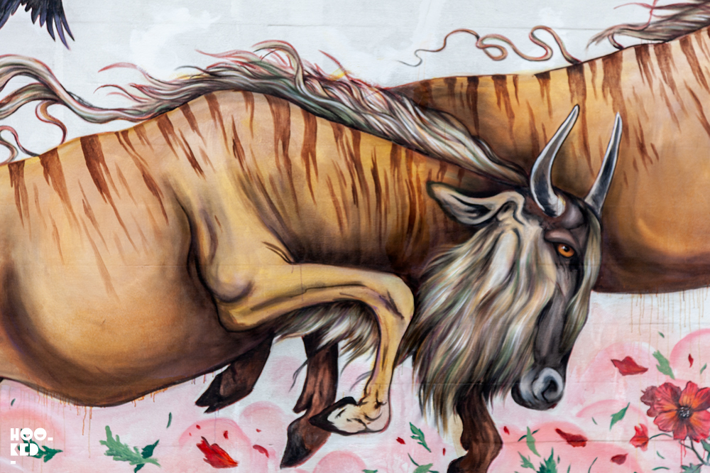 Details of the flowers and buffalo in artist Mateus Bailons'  Mural in Ostend