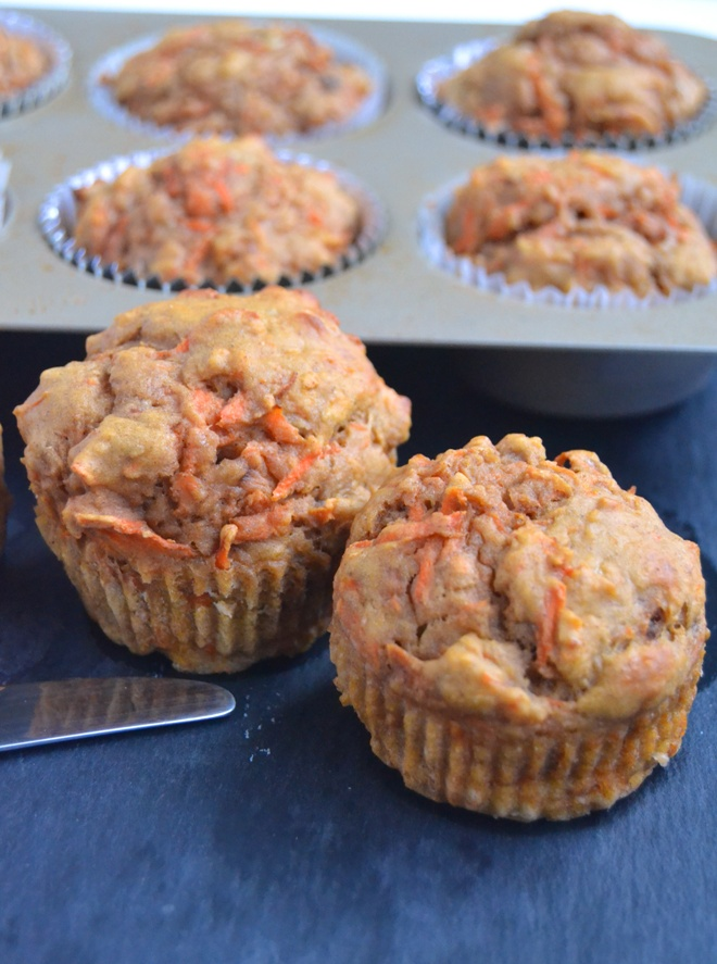 Greek Yogurt Carrot Cake Muffins are whole-grain, super moist and topped with a delicious Greek yogurt cream cheese frosting and walnuts! www.nutritionistreviews.com