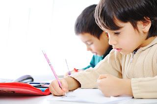 boys writing math problems