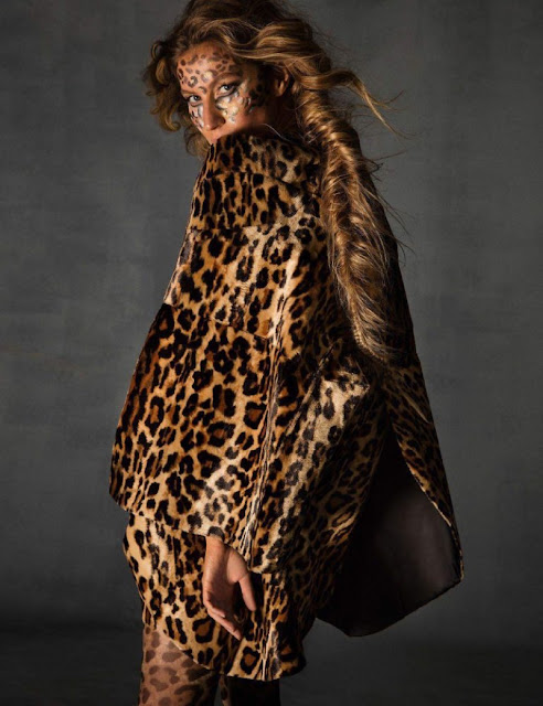 Gisele Bundchen for Vogue Paris by Inez and Vinoodh wearing a coat by Junya Watanabe