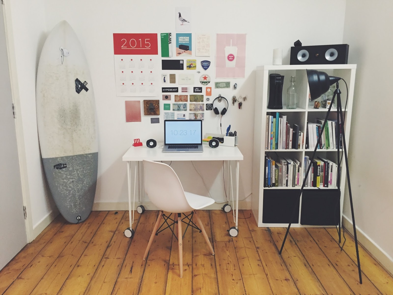 Organised office with desk and surfboard