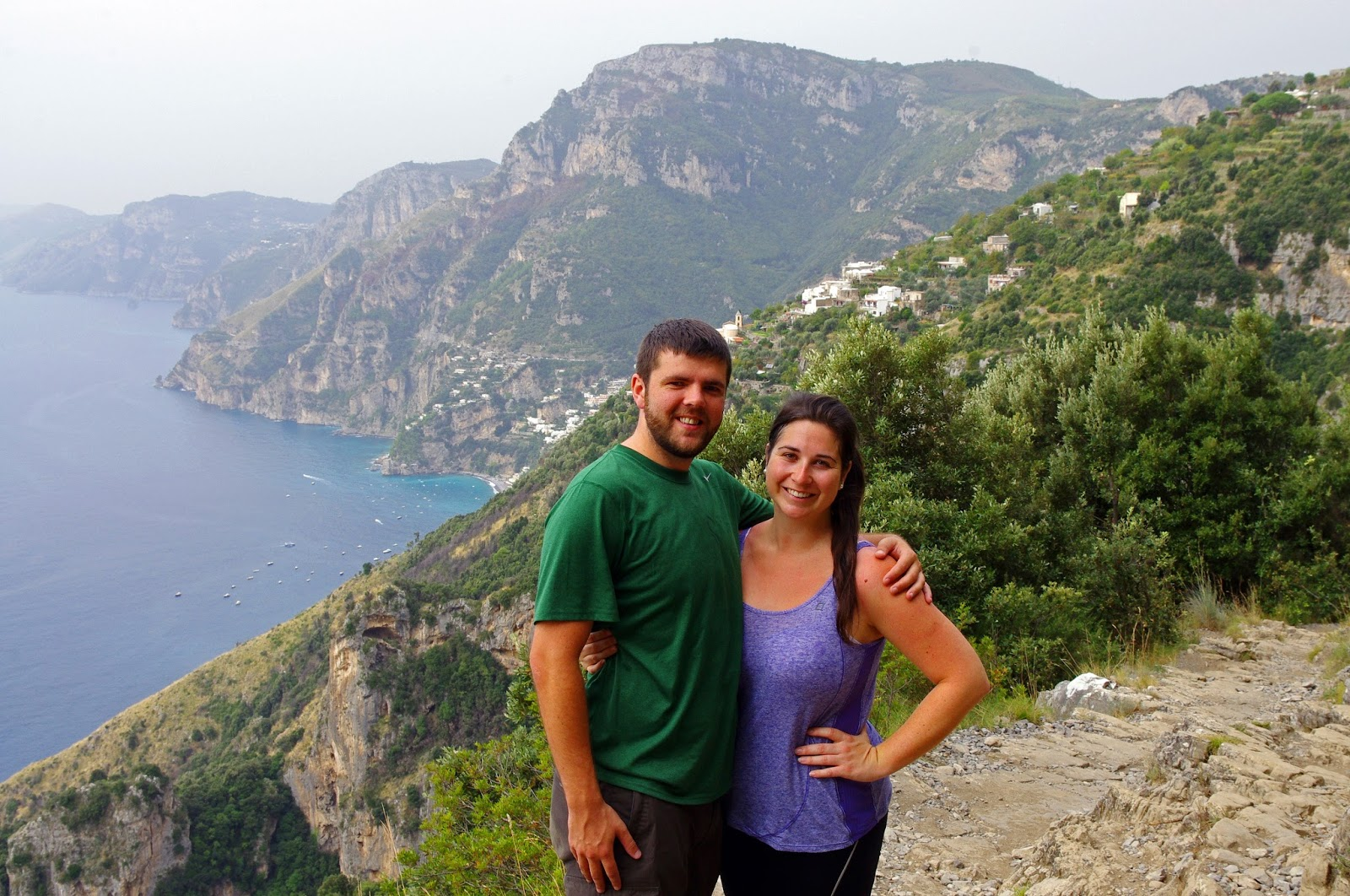 Couple hiking Walk of the Gods in Italy